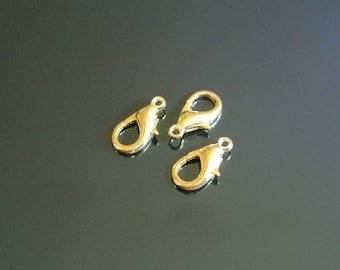 Set of five size 16 x 8 mm gold colored metal hooks
