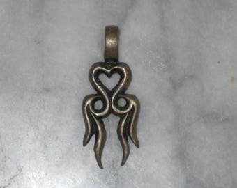 Burning heart pendant