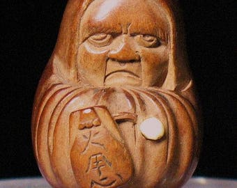 Japanese wood netsuke of Daruma 19 century