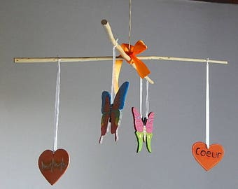 wooden mobile hanging hearts and butterflies