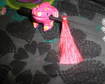 The large Pompom coral pink tassel with silver plated ring