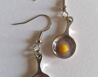 in his pan fried egg earrings