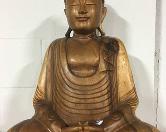 Buddha wooden statue.