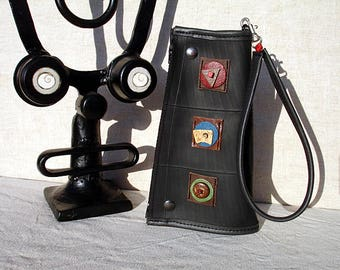 Convertible handbag clutch in inner tube recycled and cabochons of leather.