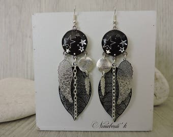 Star earrings and silver and black prints