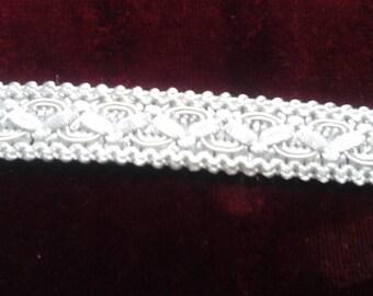 Very nice white braid trimmings.