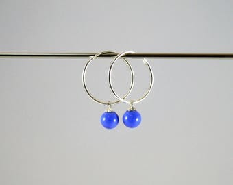 20mm sterling silver hoops and blue murano glass beads. Made by Rosa Rueda