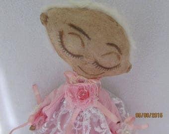 Interior sleeping Angel doll