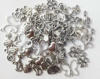 50 different charms, antique silver metal