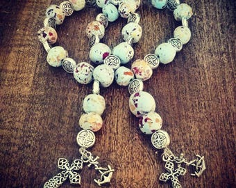 Hand made rosary beads made from dried rose petals