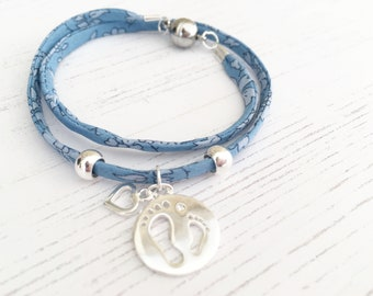 Liberty Blue Ribbon Bracelet with Sterling Silver Little Footprints Charm