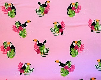 """""""Toucan"""" on pink printed cotton jersey fabric"""