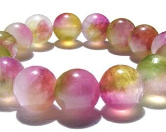 Bracelet kunzite composé de 15 perles de 14 mm blanche, verte, rose et ficelle élactic.