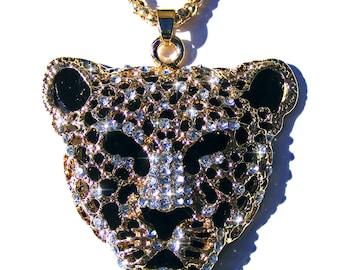 Sautoir tête de léopard doré, émaux noir, strass blanc et chaine doré.
