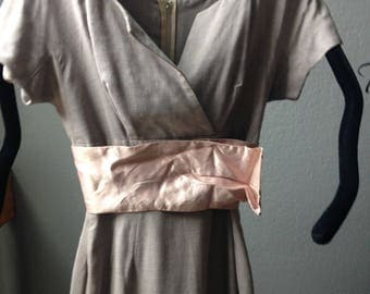 Exquisite taupe dress with blush pink sash