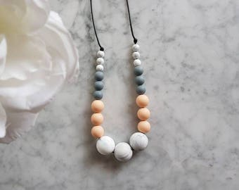 Peachy grey marble sensory necklace