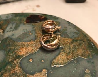 14k yellow and white gold huggie hoop earrings.