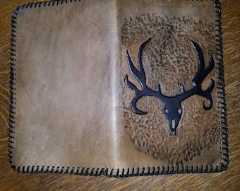 Deer skull notepad holder.