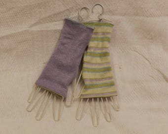 Purple and striped reversible mittens (green, purple).