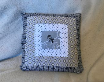 Grey bird throw pillow