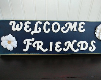 Welcome Friends wooden sign with paper flowers