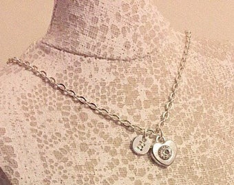 Silver plated initial and heart rhinestone charm necklace.