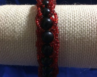 Black and red loping design bracelet