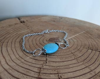 Simple Silver Bracelet with a Smooth Baby Blue Stone and Over Sized Rings