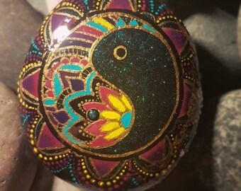 Zentangle Yin and Yang mandala. Hand painted Lake superior stone.