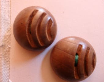 two brown wooden vintage buttons