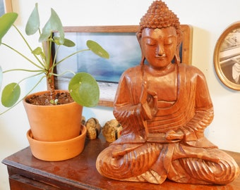 Wooden Budha in meditation handmade