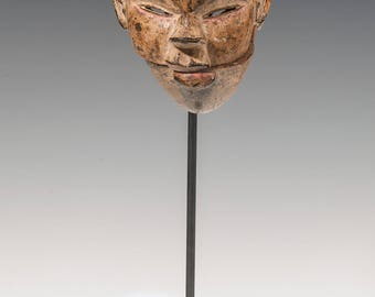 Mask of the Ogoni people. Nigeria, late nineteenth century. Carved wood.