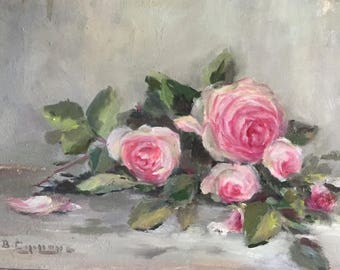Throw with pink roses on table