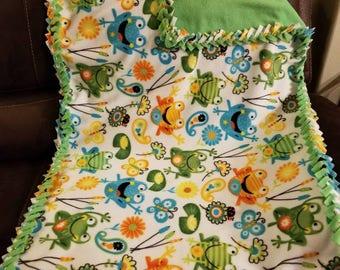 Frog fleece lap blanket.