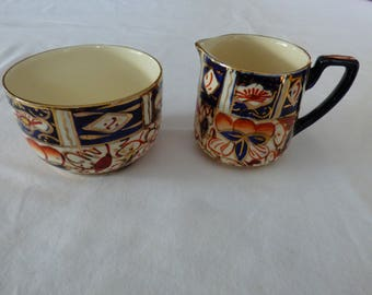 Miniature sugar bowl and cream jug