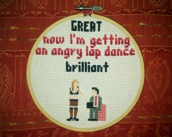 Peep show cross stitch in embroidery hoop
