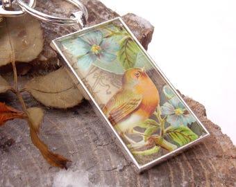 Red Robin springtime floral silvertone keychain