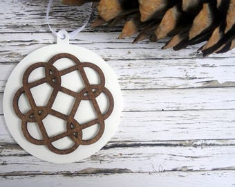 Celtic Knot Christmas ornament / tree decoration. White round bauble with natural dark wood Celtic design.