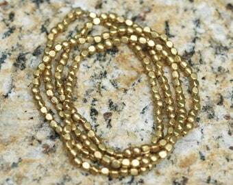 """Nepalese Small Brass Beads ~ Rounded Squares ~ 3x4mm ~ 34"""" strand"""