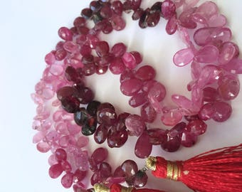 Faceted ruby pear brio 7.5mm to 9.5mm