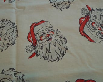 Small Christmas tablecloth with Santa faces with red hat and gray beard,  Christmas fabric / material with Santa faces with gray beard