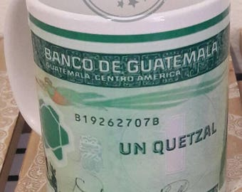 Un  Quetzal Guatemala money taza coffee mug cup