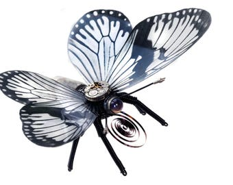 Steampunk Retro-futurist butterfly sculpture with recycled watch movement vacuum tube insect cyberpunk artwork clockwork upcycling