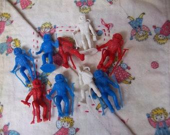 nine plastic astronauts