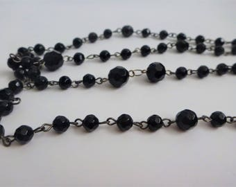 black lucite long necklace. beaded necklace. faceted bead necklace. flapper necklace.