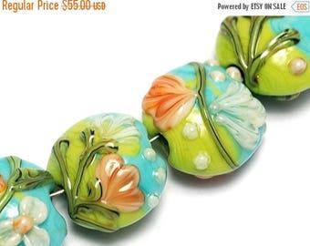 ON SALE 30% off Glass Lampwork Bead Set - Seven White w/Orange Flora Lentil Beads 10504302