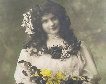 1900s French postcard, Lady with yellow flowers. RPPC real photo postcard.