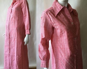 MOVING SALE Vintage 1970's shirt dress / artist's smock, red & white plaid seersucker with pinwheel snaps, long length with long sleeves, me