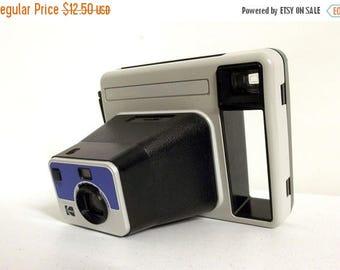 """Vintage Kodak """"The Handle"""" instant camera with brown shoulder bag"""