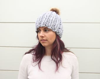 Chunky knit hat with faux fur pom pom